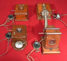 Four antique telephones, early 20th century