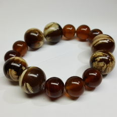 Bracelet of Mexican amber beads of  cognac / brown colour, not motified, 38.3 grams, no reserve price