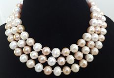 Long necklace with large freshwater cultured pink and white pearls