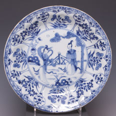 "Beautiful, blue white porcelain plate, ""lange lijzen"" (tall, slender female figures) in garden - China - early 18th century (Kangxi period)."