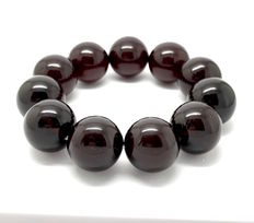 Bracelet of Baltic amber beads of 17 mm, cherry colour, 30.6 grams