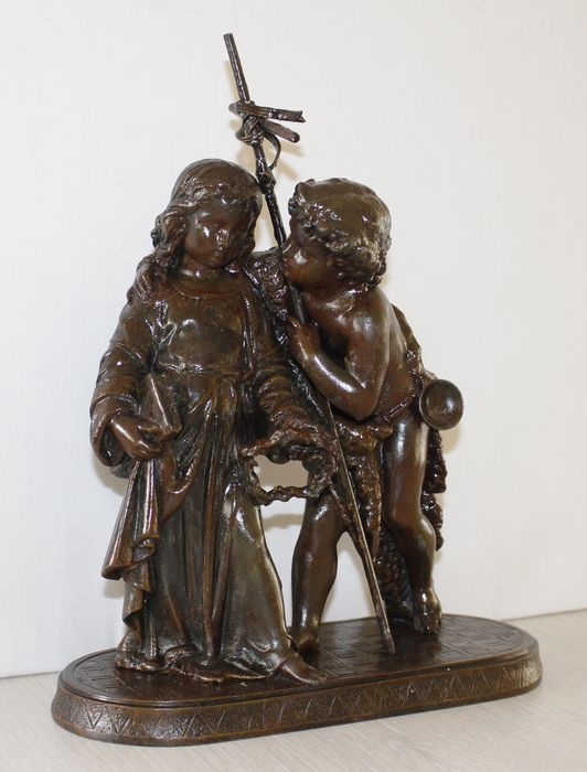 Religious statue of a boy and a girl.