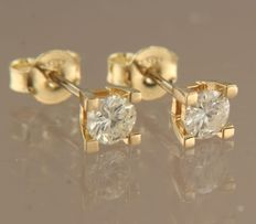 SSA 27 April 14k yellow gold solitaire ear studs set with brilliant cut diamond of in total approx. 0.74 carat