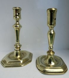 2 early brass candlesticks with octagonal feet-Low Countries-late 17th century and ca. 1700