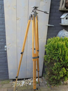 A wooden tripod whole adjustable brand unknown.