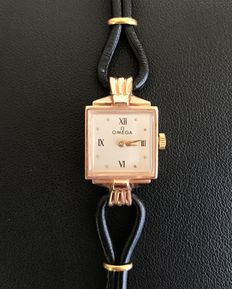 Tank-style mechanical ladies' watch in 14 kt gold with leather strap in perfect condition, Omega