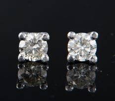 14 kt white gold solitaire ear studs set with brilliant cut diamond, approx. 1.44 carat in total