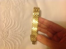 A wide 18 kt gold-plated bracelet