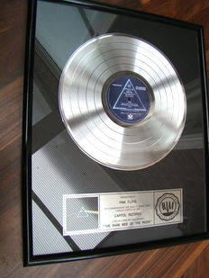 "Presented to Pink Floyd ""The Dark Side of the moon"" RIAA Platinum award"