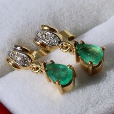 14 kt Yellow gold earrings, each with teadrop natural Emerald and small diamonds in white gold. ca. 1960.