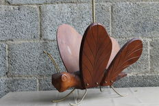 Designer unknown – Decorative vintage newspaper holder in the shape of an insect