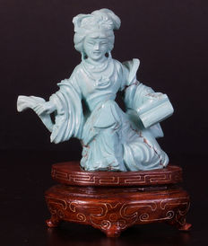 Turquoise stone sculpture of lady on wooden base - China - first half 20th century