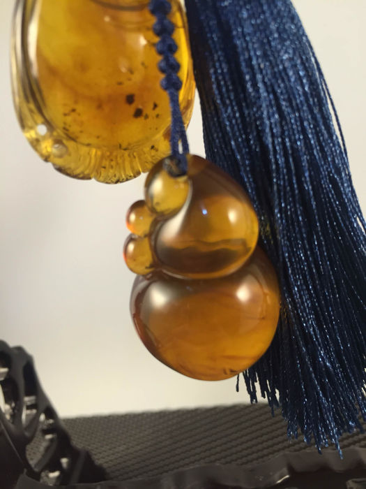 Burma Amber ornaments/pendants on hand woven rope, weighs 20 grams