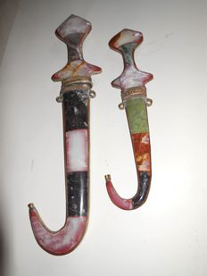 Two antique Arabian daggers Jambiya with sheath in gemstone and brass/bronze fitting