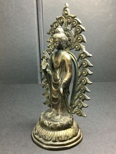 Standing Buddha in patinated bronze - Nepal - second half of the 20th century