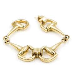 Bracelet in yellow gold with bracket motif links and safety chain