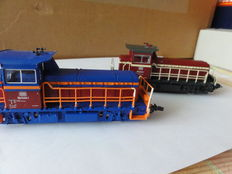Roco H0 - 48012 - 2 diesel locomotives: working locomotive 2 and 3 of the DB, blue and red