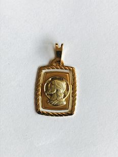 18kt Gold pendant, 3,1 grams, 18 Kt, with the face of Jesus.