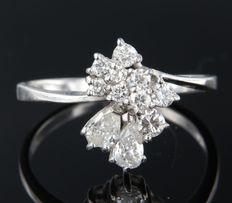 18k white gold ring set with pear-shaped and brilliant cut diamonds of approx. 0.60 carat in total