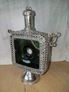 Arabic signed perfume bottle with silver plated holder..