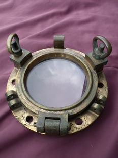 Antique bronze porthole with glass.