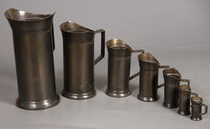 19-piece collection of Pewter utensils, including measuring jugs