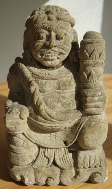 Stone statue of a gate guardian – Java – Indonesia