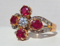 Ring with 4 rubies and 17 diamonds on yellow and white gold of 18 kt