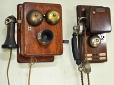 Two antique wooden telephones with crank