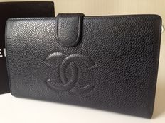 Chanel caviar leather wallet.