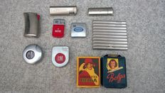 2 old packs of Belga cigarettes with 6 lighters.
