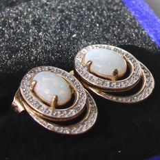 Gold earrings with opal and two small diamonds