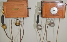 Two antique wooden wall telephones with crank, France, early 20th century