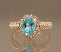 Rose gold entourage ring of 14 kt, set in the centre with an oval cut blue topaz and 47 brilliant cut diamonds of approx. 0.45 carat in total ** No reserve price **