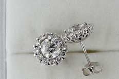 3.04 ct D/SI1 round diamond earrings 14 kt white gold