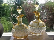 2 Uberfang cut and engraved decanters with handle, Bohemia, approx. 1900