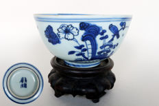 Bowl painted in blue and white with birds between rocks and blossoms - China - circa 16th/17th century (Ming dynasty)