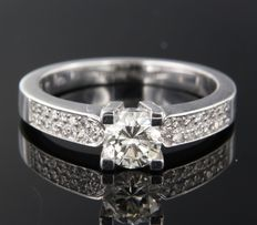 14k white gold ring set with a central brilliant cut diamond and smaller ones on the shank, in total approx. 0.84 carat.