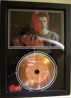 David Bowie, signed( printed facsimile signatures )framed photo, and gold record effect CD disc presentation( Rebel Rebel ).