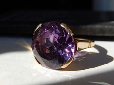 Heavy, 18 kt yellow gold, antique ring and large round amethyst.