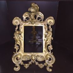 A richly ornamented brass photo frame, France, 1st half of 20th century