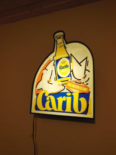 Light box Carib beer ca. 1980 and Bud beer bottle.