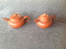 Two beautiful small Yixing teapots made of red clay- China - 19th century