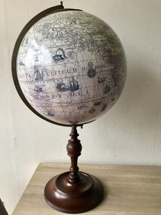 Large handmade globe with old ship routes.