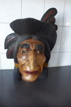 Very large Indian face carved from wood