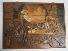 Wood carvings wall panel: Two chess players around a chessboard