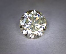 0.56 ct round cut fancy yellow diamond, VS2