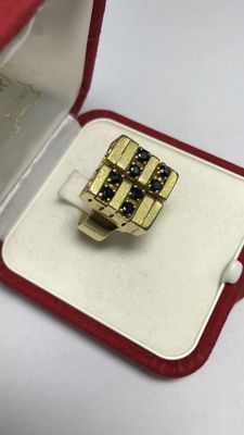 Ring in 18 kt gold with sapphires