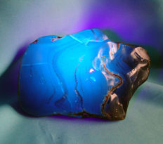 Blue amber, natural, polished on one side, 152 x 101 x 76 mm. 495 gr. / 2475 ct.
