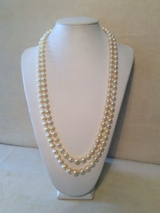 Pearl necklace, 7.5 mm – 10 mm.Double strand with clasp in gold set with 13 sapphires, totalling 0.25 ct.